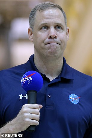 Jim Bridenstine (pictured in August) reignited the debate by stating Pluto should be a planet because it has an ocean under its surface, organic compounds on its surface and its own moons