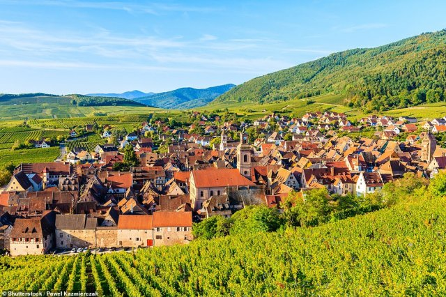 The Alsatian village of Riquewihr is 'besieged by vines' - so finding a nice glass of wine there isn't difficult. But make sure you reserve plenty of time for gawping at the colourful half-timbered houses