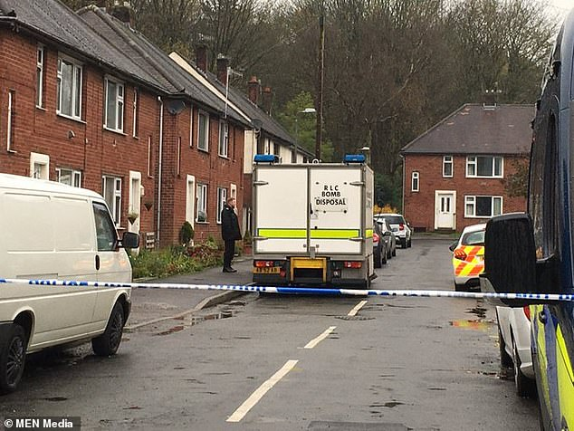 The device was discovered during a pre-planned dawn raid this morning in Ramsbottom, where a bomb disposal team is pictured