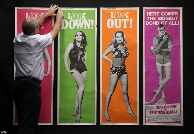The world's largest collection of James Bond posters has been sold at auction for almost a quarter of a million pounds including US Door Panel ads for the 1965 James Bond film Thunderball (pictured) which sold for£12,500