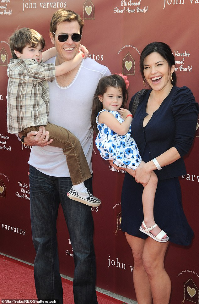Whitesell also has two children (pictured March 2011). He only went public with his relationship after his divorce from Lauren Sanchez was finalized in October