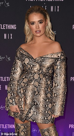 Stunning: Molly-Mae swept her blonde tresses back in a slick curled style with perfect make-up