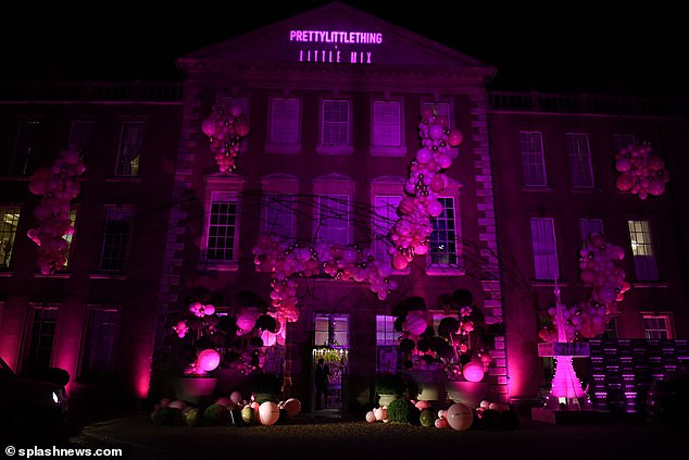 Pulling out the stops!Aynhoe Park House was illuminated in pink light and covered in balloons