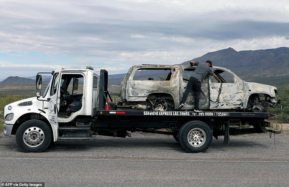 Devastated family members of the slain victims visited the scene of the grisly murders late on Tuesday and were pictured sobbing as they saw the burnt out and bullet riddled SUVs. Authorities were spotted hauling away the burnt wreck from the scene on Wednesday