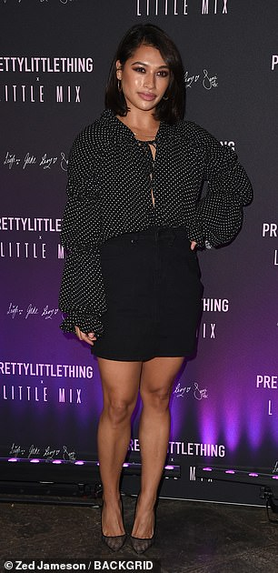 Glam! The Saturday's Vanessa White looked chic in a polka dot blouse and black mini skirt