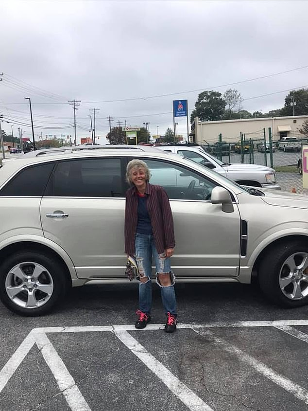 A GoFundMe page helped raise $8,265, just short of a $10000 goal, to purchase a used, silver crossover SUV that was given to package handler Darlene Quinn (pictured with the vehicle), who works at a South Carolina FedEx store, to replace her broken down car