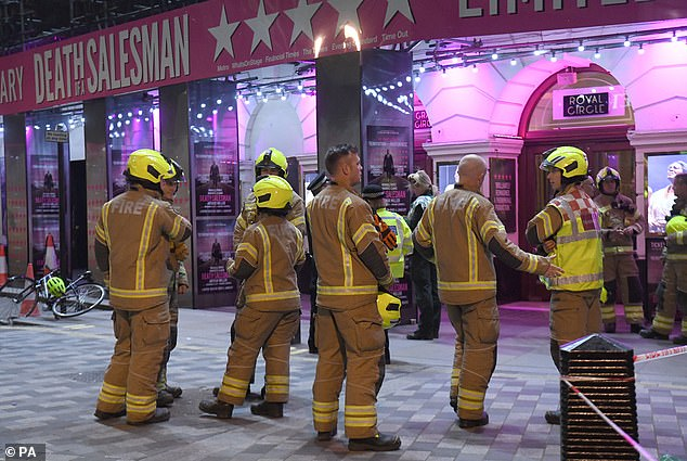Firefighters outside the Piccadilly Theatre after it was evacuated when a piece of the roof fell onto the audience