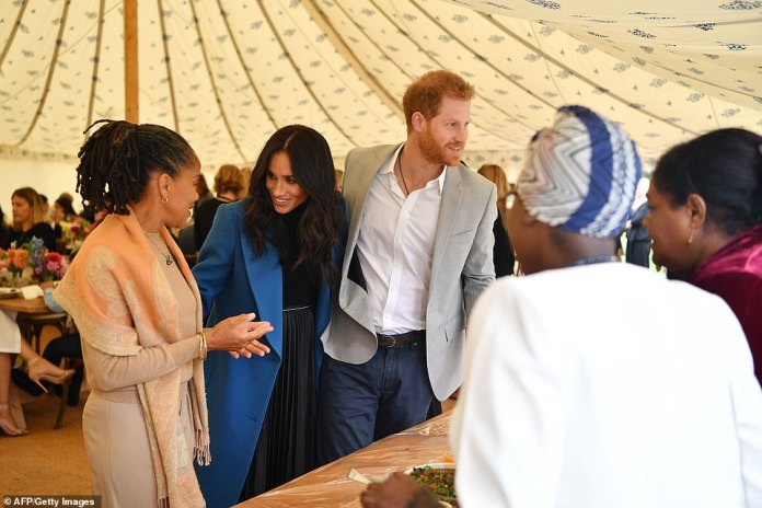 Meghan, her mother Doria and Harry launch a cookbook with women affected by Grenfell at Kensington Palace last autumn