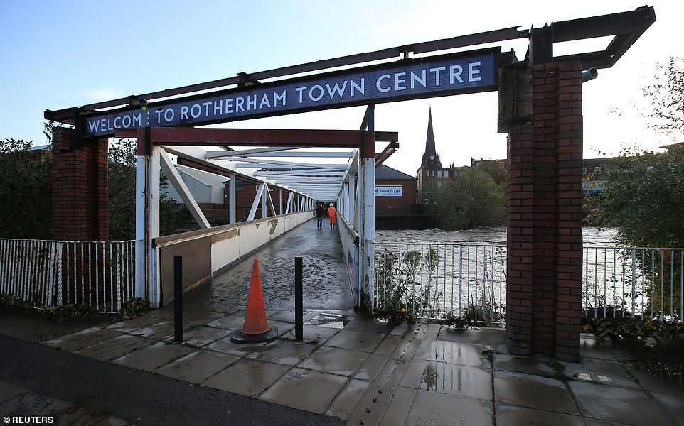 A bridge with a sign welcoming visitors to Rotherham town centre this morning after floodwaters rose in South Yorkshire