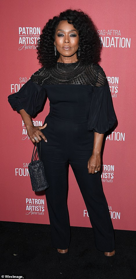 Bassett, 71, looked fabulous in a black top with embellished bodice and black slacks and heels