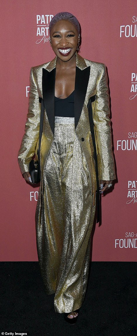 Cynthia Erivo, 32, arrived wearing a shimmery gold pantsuit and a low-cut black top
