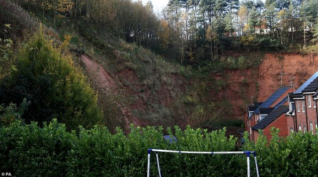 The aftermath of the mudslide, pictured today, which has forced people to evacuate their homes in Mansfield