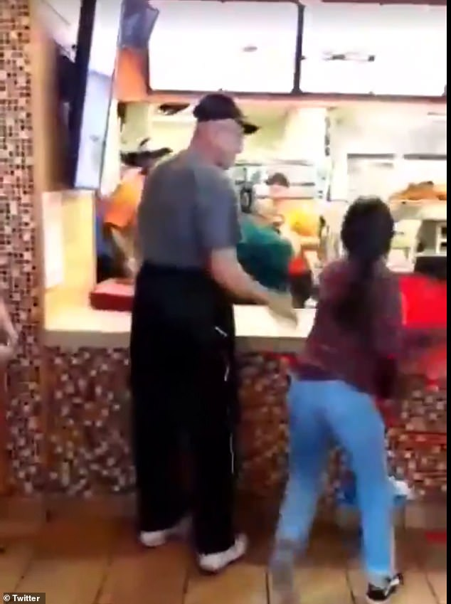 Shocking footage has emerged of a cashier and customer throwing trays at each other at a Popeyes restaurant in San Antonio