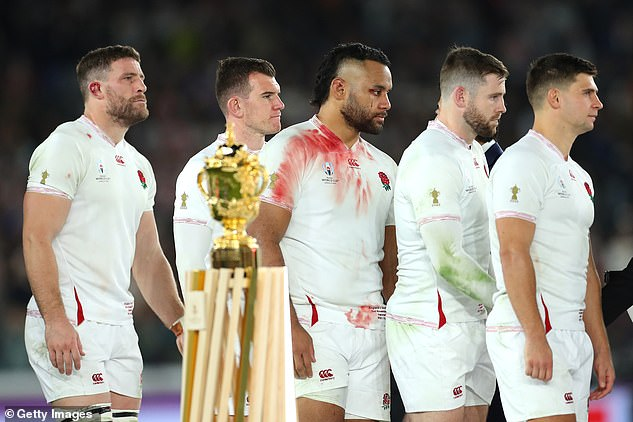 England players walk past the Webb Ellis trophy and they prepare to receive their medals