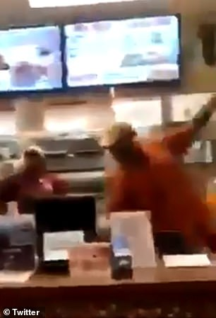 The cashier throws the container back at the man