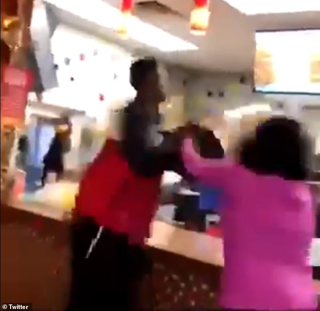 In footage on Wednesday, a man threw an entire bucket of tea over a Popeyes worker at an unidentified location because he was angry he couldn't get a chicken sandwich