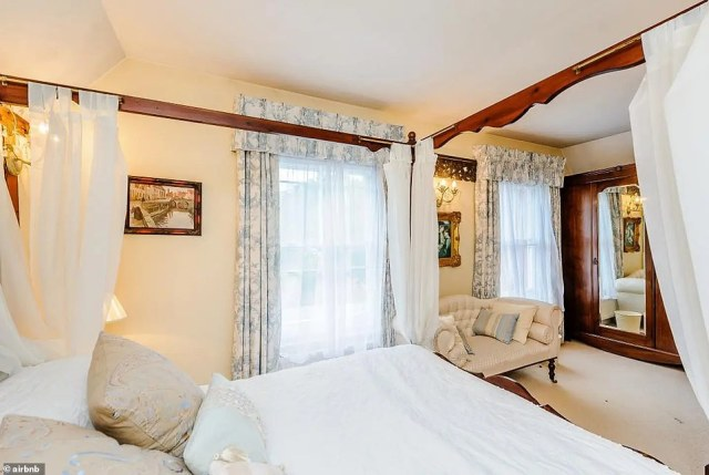 According to the listing, its owners live in the main house and 'love talking about its history and that of our amazing village'. Pictured: one of the bedrooms available to book on Airbnb