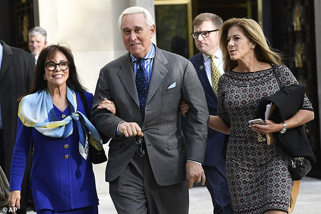 Longtime Trump confidante Roger Stone, pictured leaving to court with his wife in a gray three-button suit jack and blue striped shirt with a cutaway collar and spotted tie, previously told Congress that Randy Credico was his back channel to WikiLeaks' Julian Assange