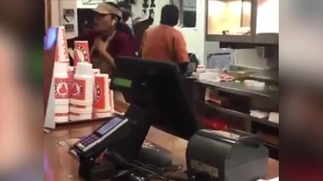 One female worker can be heard saying: 'You f*****g hit me b***h, I got hit.' One male worker is seen with his arm over another female worker and it's unclear if he has her in a headlock or if he is trying to assist her