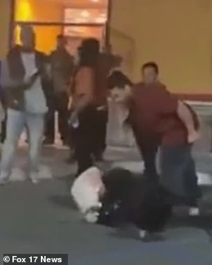 The woman is body slammed to the ground