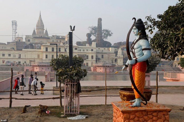 A statue of the Hindu god Rama stands on the Sarayu River in Ayodhya, India.