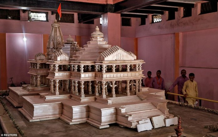 The judge said that a temple for the Hindu god Ram should be built on the disputed plot by forming a trust under the control of the central government. We see devotees inspecting a model of the temple Ram proposed in the city