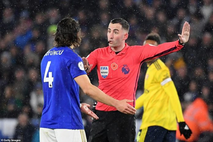 Referee Chris Kavanagh was unmoved after Caglar Soyuncu appeared to be dragged back inside the box by Guendouzi