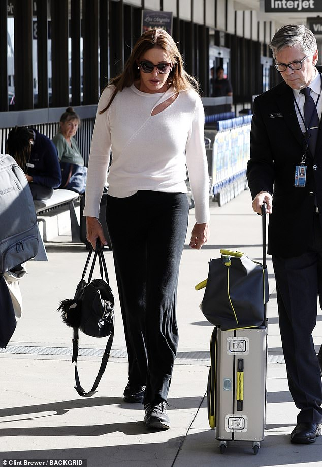 On the way to the jungle: Caitlyn's headed to the check-in counter of Australian companies with just a small carry-on bag and a purse while she was preparing to leave Los Angeles the day before