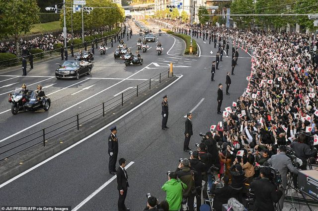The parade (pictured was the first since Naruhito and Masako's marriage in June 1993, just three years after their parents celebrated their enthronement in a Rolls Royce