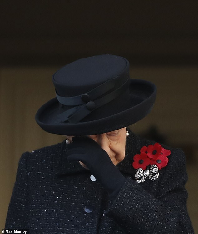The Queen was seen wiping her eyes as she joined other members of the royal family to attend the annual Remembrance Sunday Service at The Cenotap