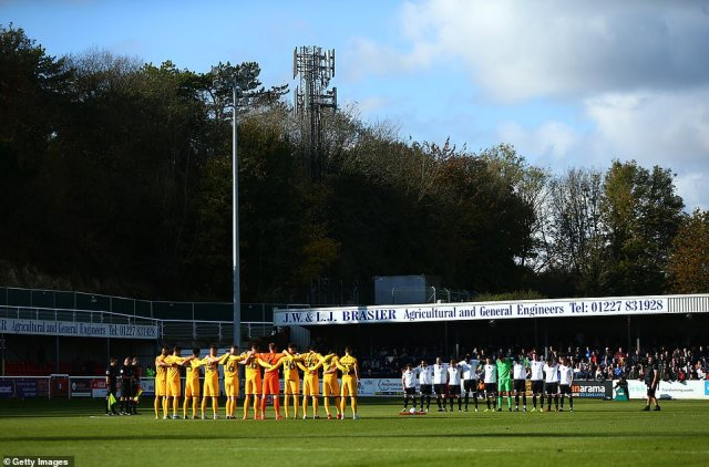 A silence is observed by fans, officials and players for Remembrance Day prior to the FA Cup First Round match between Dover Athletic and Southend United