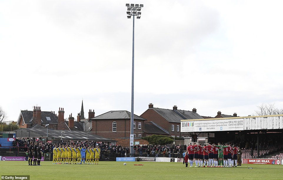 York City and Altrincham players bow their heads for a minute silence in honour of Remembrance Day at Bootham Crescent ahead of the FA Cup First Round tie