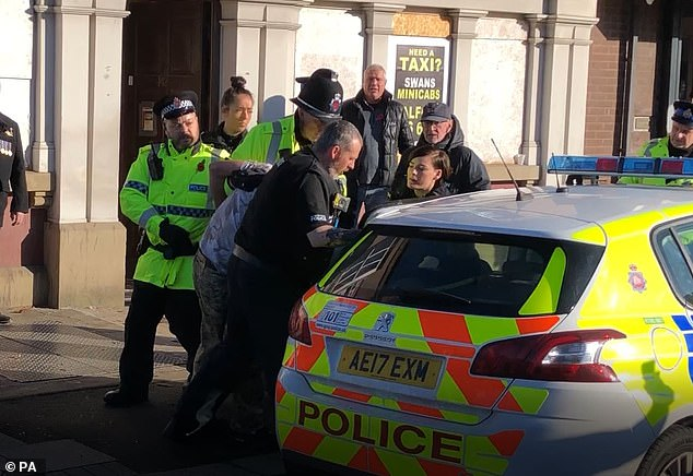 Police reinforcements soon arrived and the man, handcuffed with his head held down, was rushed out of the pub to a waiting police car which quickly sped away