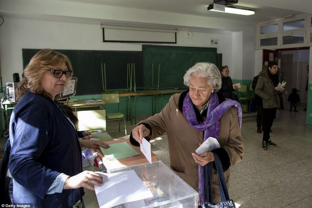 A woman casts her vote in Madrid, Spain, during the country's general election. In a move that could garner further support the PSOE government has exhumed the body of the country's former dictator Francisco Franco
