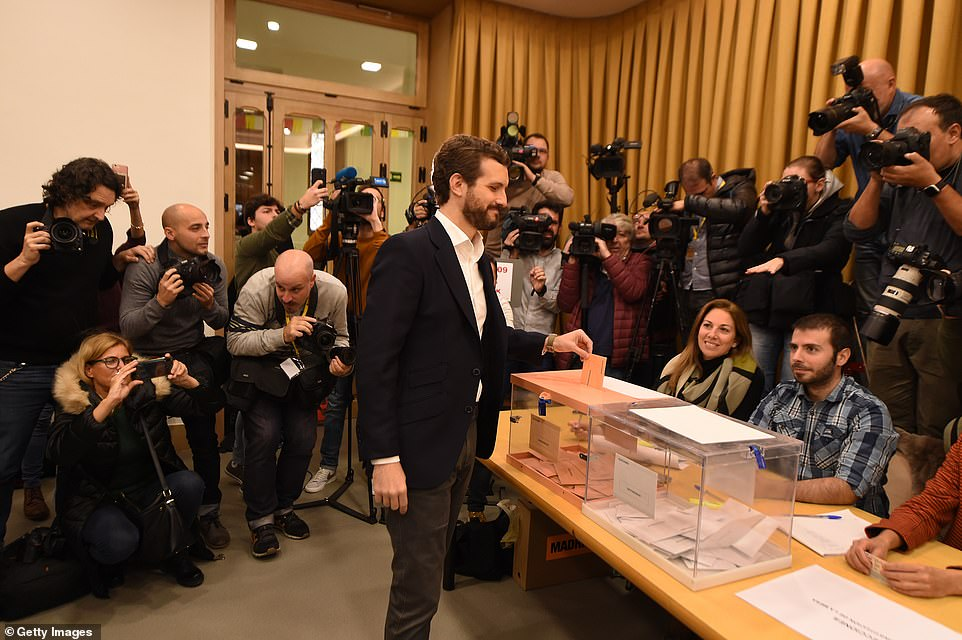 Spain's socialist Prime Minister's conservative rival Pablo Casado, of the People's Party, casts his vote in the capital. Polls suggest his party may gain several additional seats
