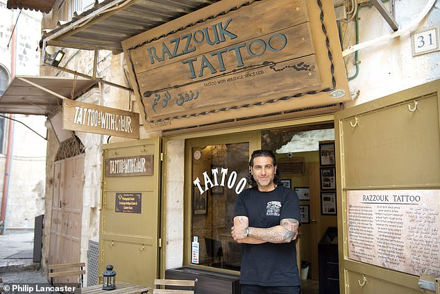 Wassim Razzouk outside his shop.The Razzouk family have been tattooing Christian pilgrims since the year 1300
