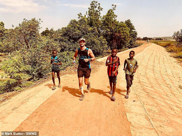 Nick is pictured running with children inNaimey, in the west African country of Niger. He has said: 'You don't know when you're time is going to run out, so get out there and chase your dreams today - as Kevin said, don't wait for the diagnosis'