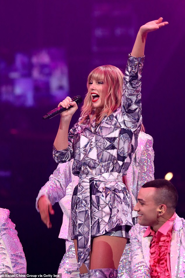 Commanding attention: The award-winning musician, 29, has been performed on a bedazzled belted jacket, embellished with geometric printing