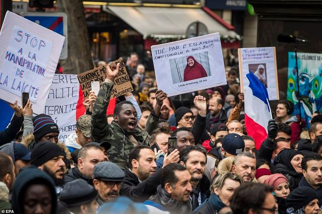 Last month, a member of Le Pen's National Rally party fuelled an ongoing debate about the position of Muslims and Muslim symbols in France by publicly telling a woman to remove her headscarf. Pictured: Today's march in Paris