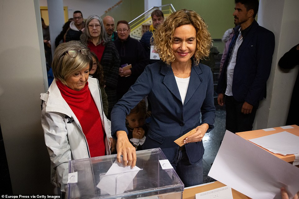 Amposta Mayor Adam Tomas said the 70-year-old man was carrying the weapon in a bag and was arrested when he refused to show it police officers inside the polling station in the town in the region of Catalonia. Pictured:The head of the list of PSOE to the Parliament by Barcelona, Meritxell Batet voting