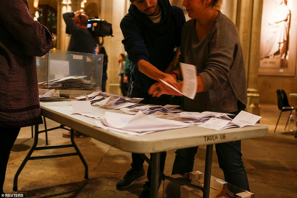 Surrounded by supporters, Abascal, 43, said he did not have many expectations Sunday but hoped 'the election serves to reinforce Spanish unity.' Pictured: Votes being counted in Barcelona