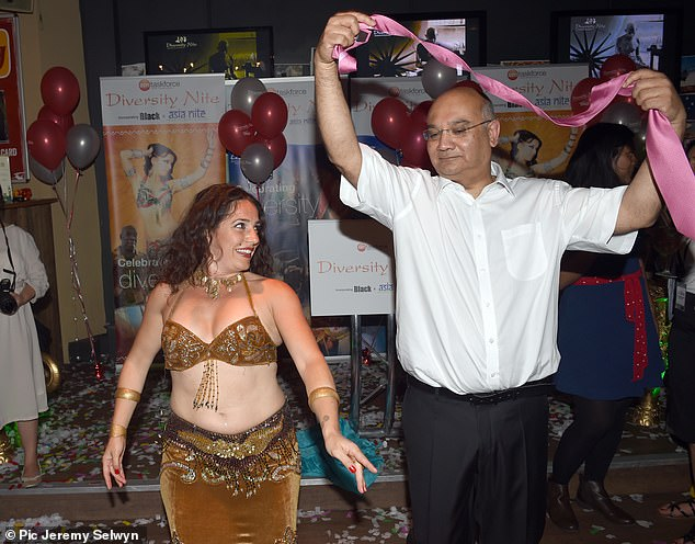 Keith Vaz dances with a belly dancer at the Labour party 'Diversity' night in Brighton at the Labour Party Conference in 2015