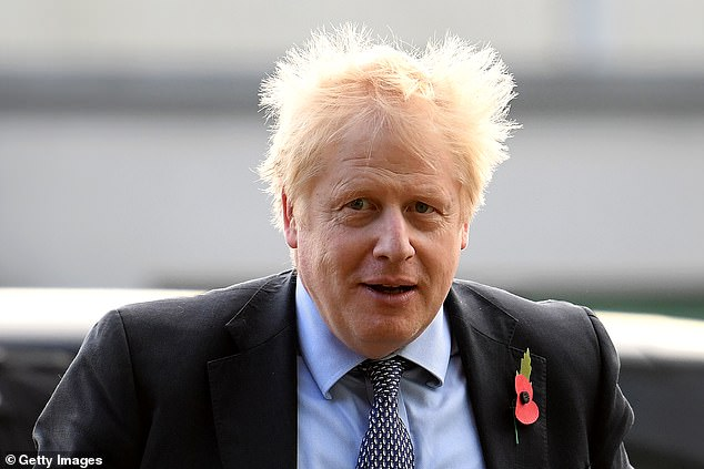 Prime Minister Boris Johnson arrives for a general election campaign visit to Diageo's Roseisle Distillery near Elgin in Scotland on Thursday