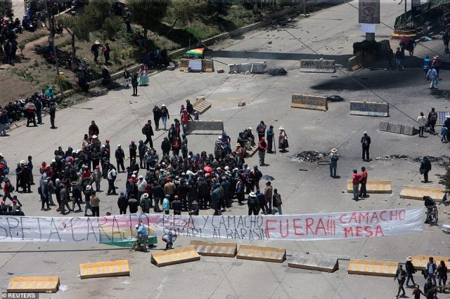 Supporters of Bolivia's now former President Evo Morales block a street in La Paz, on Sunday