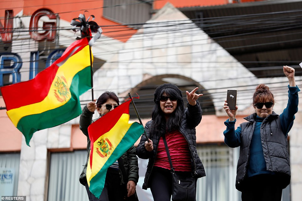 People celebrate after Bolivia's now former President Evo Morales announced his resignation in La Paz on Sunday