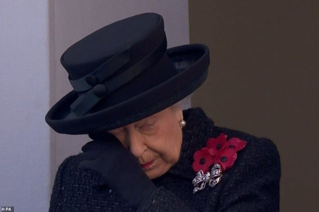 The Queen lead the UK in a two-minute silence for Remembrance Sunday this morning, as huge crowds gathered in central London to pay their respects to the war dead. Her Majesty is pictured shedding a tear above
