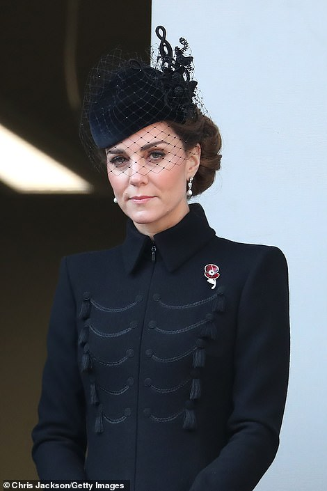Flanked by the Duchesses of Cornwall and Cambridge, the Queen looked on from a balcony as the Prince of Wales placed her wreath on the Cenotaph before laying his own tribute. The Duchess of Cambridge is pictured above