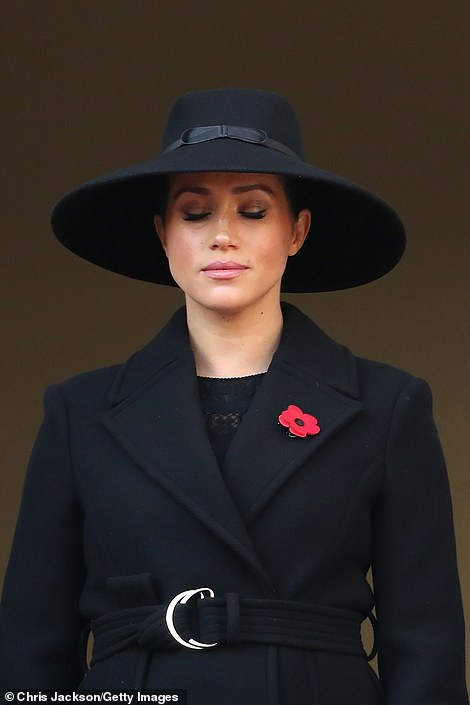'Isn't it freezing?' the Duchess of Cornwall observed just before the start. 'Quite bracing,' added the Duchess of Cambridge. 'It's cold enough,' the Queen concurred. On the adjacent balcony, the Duchess of Sussex (above) joined the Countess of Wessex and Vice Admiral Sir Tim Laurence.
