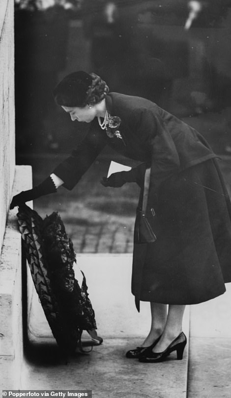 Her Majesty is pictured laying down a wreath in 1954