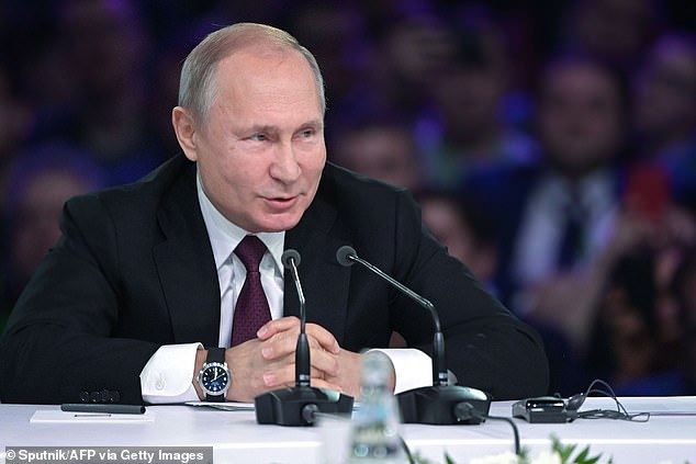 Russian President Vladimir Putin speaks during a panel discussion as part of the Artificial Intelligence Journey forum, in Moscow on November 9, 2019